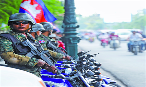 Armed military police along major streets and boulevards for the ASEAN Forum in Phnom Penh. Sec. Hillary Clinton arrived today.