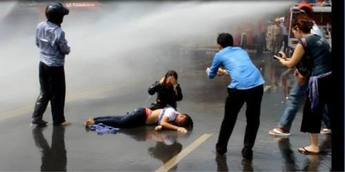 She fainted but the water canon kept on going.