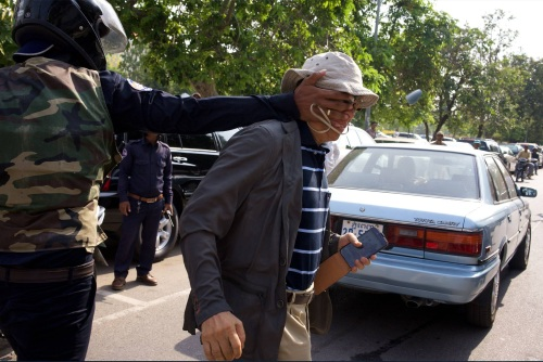 CNRP , MP-elect hit by security guard at Freedom Park- 21 April,, 2014 - photo by Ben Woods.