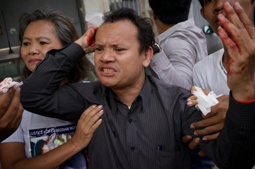 CNRP official hit at Freedom Park- 21 April, 2014. Photo Ben Woods