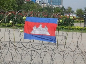 Cambodia's national flag and lotus flowers on Freedom Park barber wired