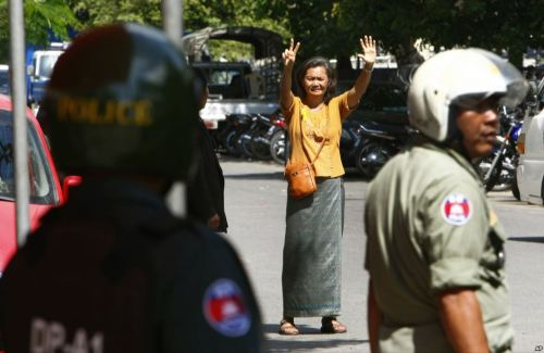 Minutes after arrest. MU Sochua holding up 7 , symbol of the opposition-AP picture