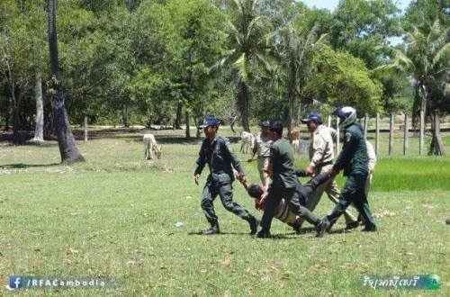 Police dragging injured villager. photo by Radio Free Asia