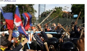 Hired thugs with batons; CNRP protesters with plastic poles and flags at Freedom Park.